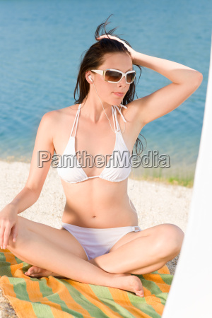 young sexy bikini model relaxing with