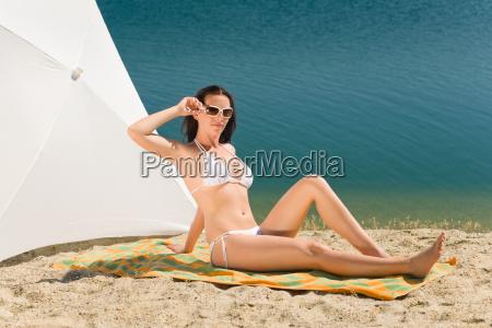 summer beach young woman sunbathing in