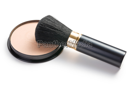 makeup brush and cosmetic powder compact