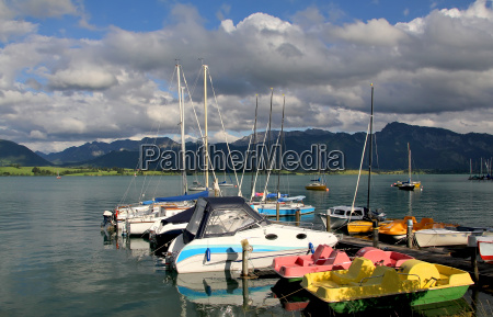 colourful boats on forggensee