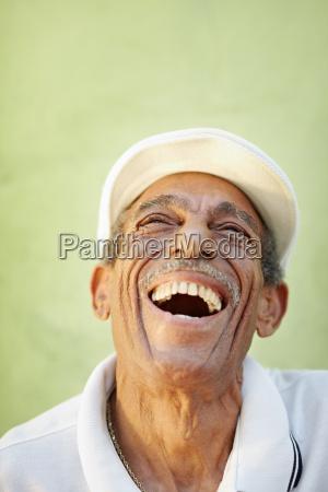 aged latino man smiling for joy