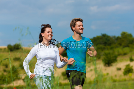 young sporty couple jogging outdoors