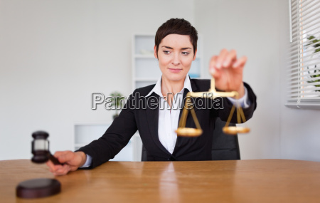 young woman with a gavel and