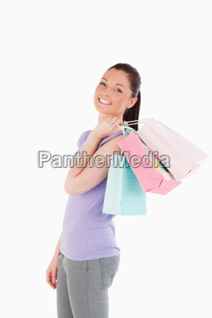 good looking woman holding shopping bags