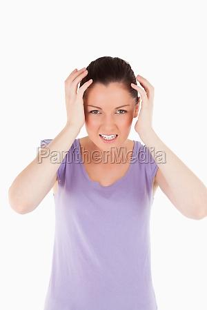 good looking woman having a migraine