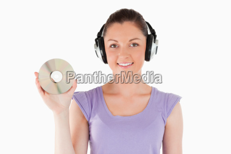 good looking woman with headphones holding