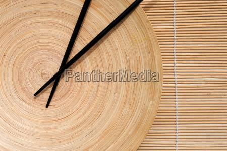japanese chopsticks in wooden round dish