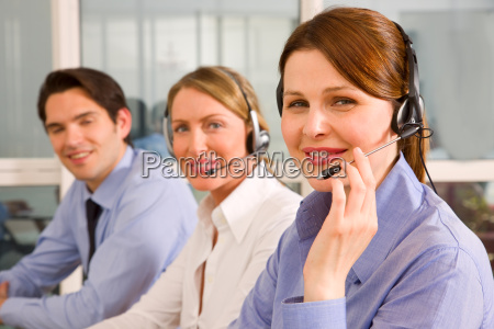 two businesswomen with microphone and a