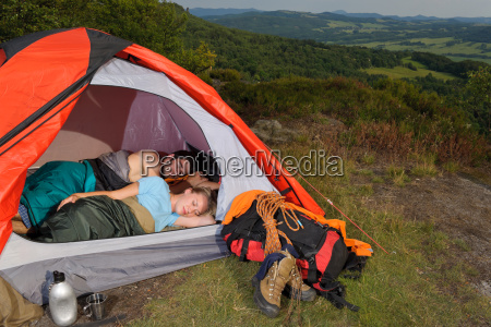 camping young couple sleeping tent climbing