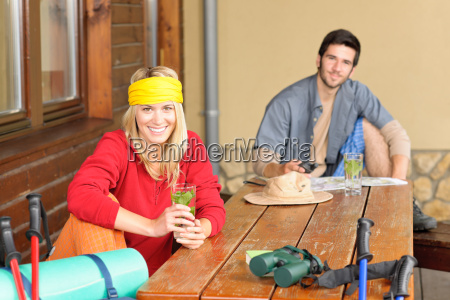 tramping young couple relax by wooden