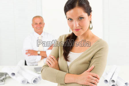 professional architect woman with blueprint office