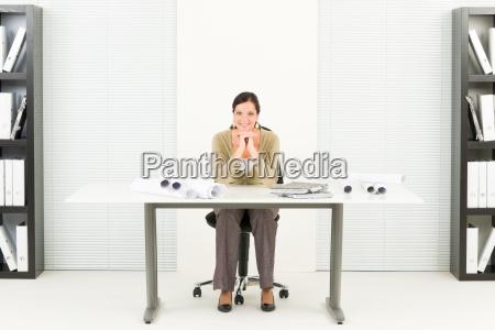 office professional architect female blueprints