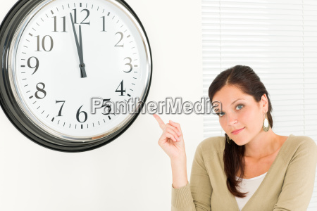 punctual businesswoman attractive point at clock