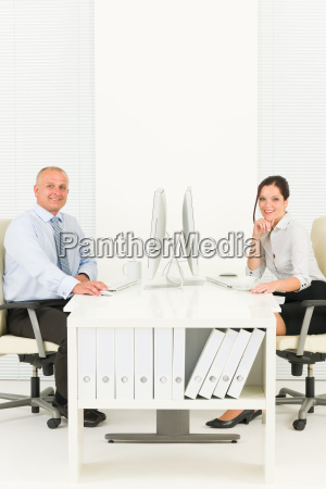 professional businesspeople sitting in office