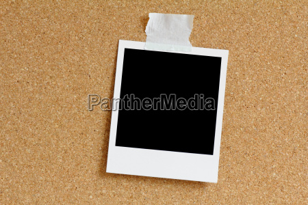 polaroid on cork pinboard
