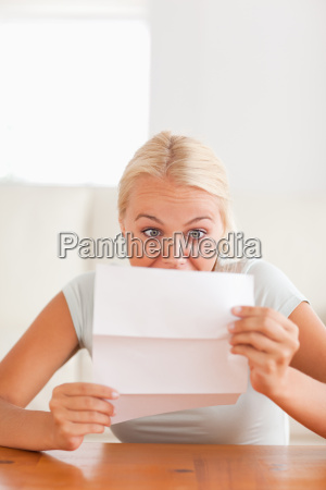 woman looking at a letter in