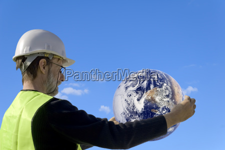 technician holding the earth