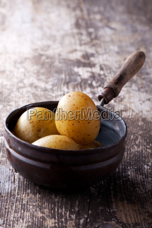 four boiled potatoes in an old