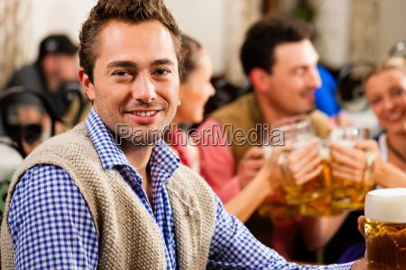 man drinking beer in bavaria