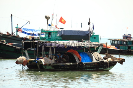 fishermen in the halong bay