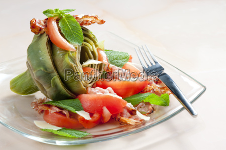 cooked artichoke with tomatoes parmesan cheese