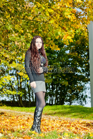 young woman in autumnal nature