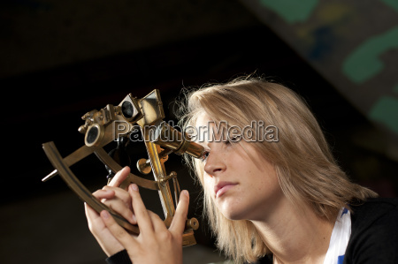 young woman with sextant