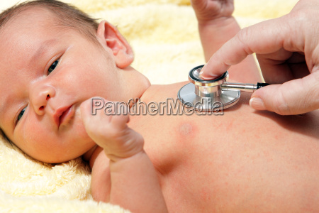stethoscope listening to a baby039s heart