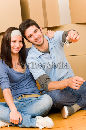 moving new home young couple hold