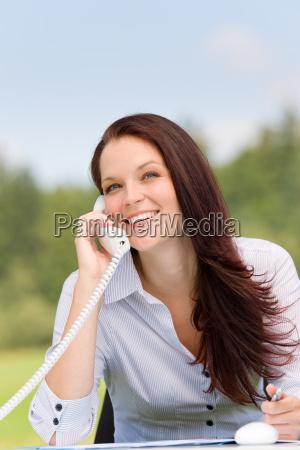 businesswoman in nature attractive smile calling