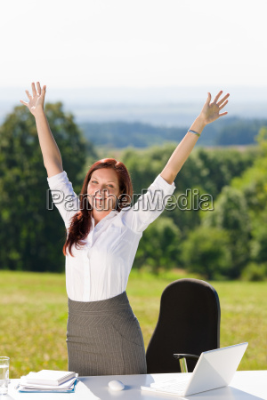 businesswoman in sunny nature office hands