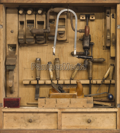carpenters tools in a wooden cabinet