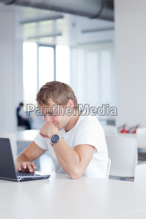 young male college student working on