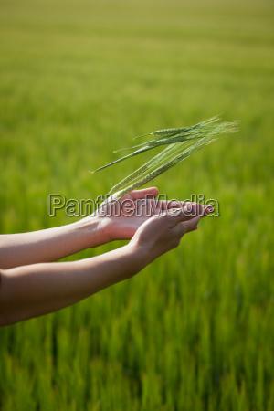 symbolic gesture suggesting fertility plenitude health