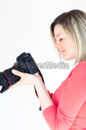 pretty female photographer with her digital