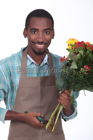 florist with bouquet of flowers on