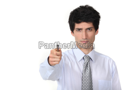 man in a suit holding a