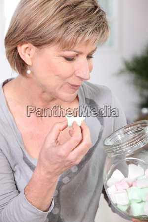 woman eating marshmallows straight out of