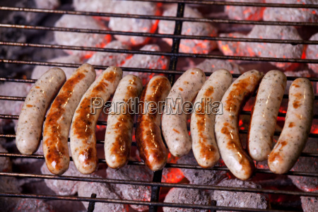 frankish sausages on a charcoal grill