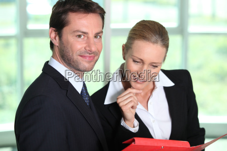 businesswoman looking at businessman039s notes