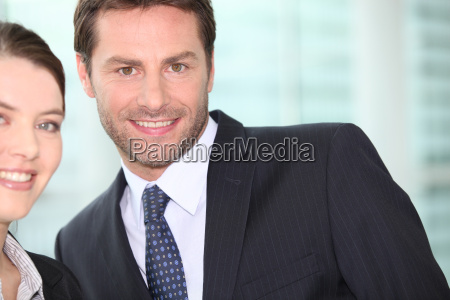 businessman smiling with woman