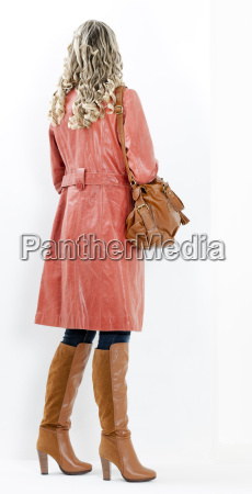 woman wearing fashionable brown boots with
