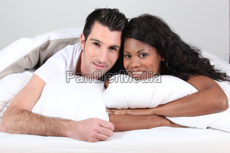 man and woman smiling laid in