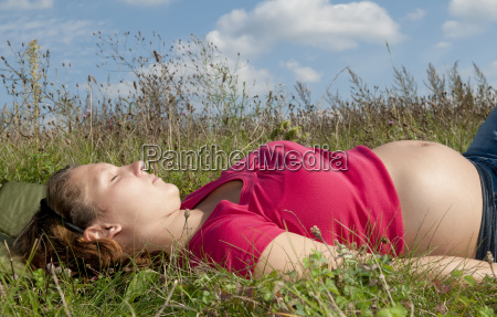 pregnant young woman relaxing on a