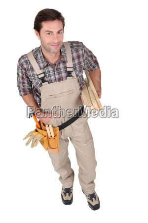 builder smiling with tools