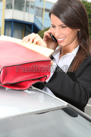 businesswoman smiling on the phone next
