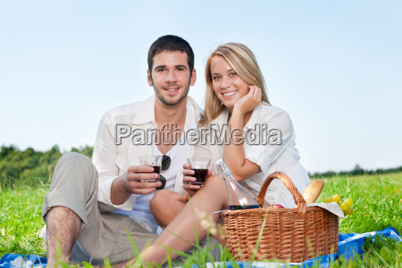 picnic young happy couple celebrating with