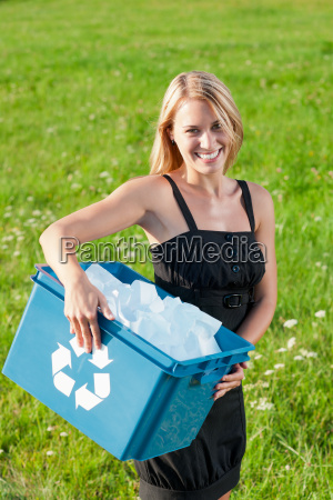 recycling paper box businesswoman in sunny