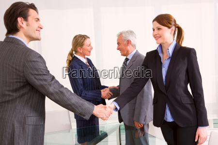 businessmen and businesswomen during a working