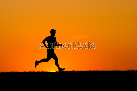 jogger in front of the evening